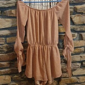 Size 8 Reverse spotted playsuit with long sleeves